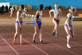 Girls run relay race Royalty Free Stock Images
