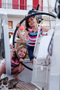 Girls on sailing boat Stock Photo