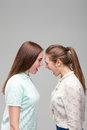 Girls screams at each other, studio photo shoot Royalty Free Stock Photo