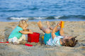 Girls at  seaside playing with sand Royalty Free Stock Photo
