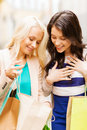 Girls with shopping bags in ctiy and tourism concept beautiful Royalty Free Stock Images