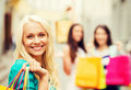 Girls with shopping bags in ctiy and tourism concept beautiful Royalty Free Stock Image