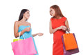 Girls shopping two cheerful young women holding bags and talking to each other Royalty Free Stock Photo