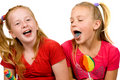 Girls are showing their blue tongue Stock Images