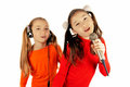 Girls singing into a microphone Stock Photos