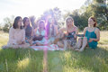 Girls Sitting Together In Gras...