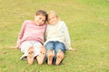 Girls with smileys on toes and soles Royalty Free Stock Photo