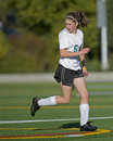 Girls soccer player on the field Royalty Free Stock Photo