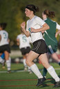 Girls soccer player on the move Royalty Free Stock Photo