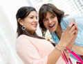 Girls social networking beautiful from a smart phone Royalty Free Stock Photography