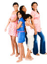Girls standing with teenage girls Royalty Free Stock Photo