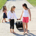 Girls with suitcase leaving their sister two barefoot black chech in baggage sad Stock Images