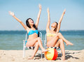 Girls sunbathing on the beach chairs summer holidays and vacation Royalty Free Stock Images