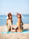 Girls sunbathing on the beach summer holidays and vacation Stock Image