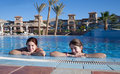 Girls in  swimming pool at resort hotel Royalty Free Stock Photo