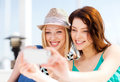 Girls taking photo in cafe on the beach summer holidays and vacation Royalty Free Stock Photos