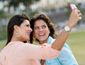 Girls taking a picture with the phone of themselves mobile Royalty Free Stock Image