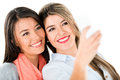 Girls taking a self protrait happy isolated over white background Stock Photo