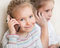 Girls talking on mobile phone Royalty Free Stock Image
