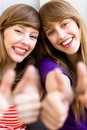 Girls with thumbs up Royalty Free Stock Photos