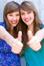 Girls with thumbs up Stock Image