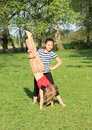 Girls training handstand exercising barefoot girl with long hair is trainging while second kid is holding her and smiling Royalty Free Stock Photography