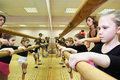 Girls trains near ballet bar Royalty Free Stock Photos