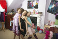 Girls in trendy bedroom at slumber party happy young striking a pose Stock Photos
