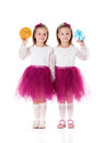 Girls twins portrait of two little with gifts isolated on white background Royalty Free Stock Photos