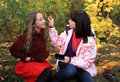 Girls use cosmetology. Royalty Free Stock Image