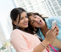 Girls using app on smart phone beautiful a Stock Photos
