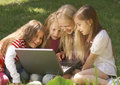 Girls using laptop Royalty Free Stock Photo