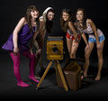 Girls with vintage camera Royalty Free Stock Photo