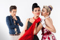 Girls in vintage dress gossip about aggravated gay Royalty Free Stock Photo