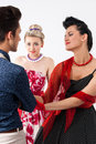 Girls in vintage dress seducing gay in presence aggravated girlf Royalty Free Stock Photo