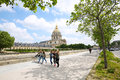 Girls walking in front of the Dome des Invalides Royalty Free Stock Photo