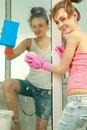 Girls washing the window Stock Photography