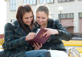 Girls watching photos in album Royalty Free Stock Photos