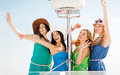 Girls waving on boat or yacht summer holidays and vacation concept Royalty Free Stock Photo