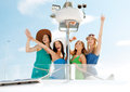 Girls waving on boat or yacht summer holidays and vacation concept Royalty Free Stock Photos