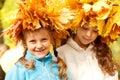 Girls wearing autumnal head wreaths Royalty Free Stock Photo