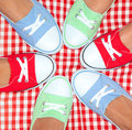 Girls wearing colorful sneakers group of shoes Royalty Free Stock Photo