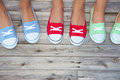 Girls wearing colorful sneakers group of shoes Stock Photography