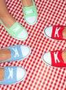 Girls wearing colorful sneakers group of shoes Stock Photo