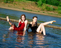 Girls in wet dress sits in water Royalty Free Stock Image