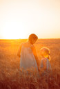 Girls on a wheat field Royalty Free Stock Photo