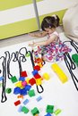 Girls who builds castles with cubes plastic Stock Image