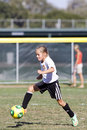 Girls Youth Soccer Football Player Kicking the Ball Royalty Free Stock Photo