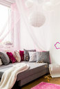 Girly bedroom with big bed image of and decorative cushions Royalty Free Stock Photos