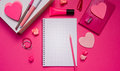 Girly desktop and stationery pink with blank notebook pencil Royalty Free Stock Images